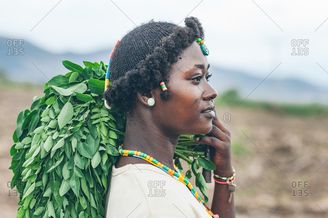March 28, 2012: Ethiopian woman holding plant leaves