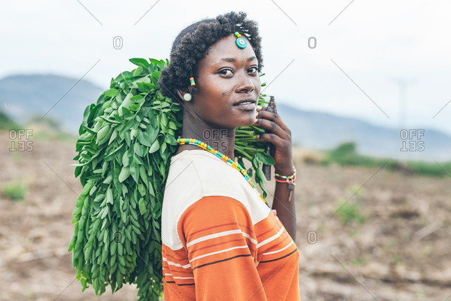 March 28, 2012: Ethiopian woman holding plants
