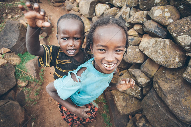 March 29, 2013: Girl carrying boy in Ethiopia