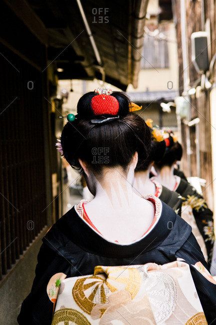 Maiko geishas observing Hassaku outside in Japan