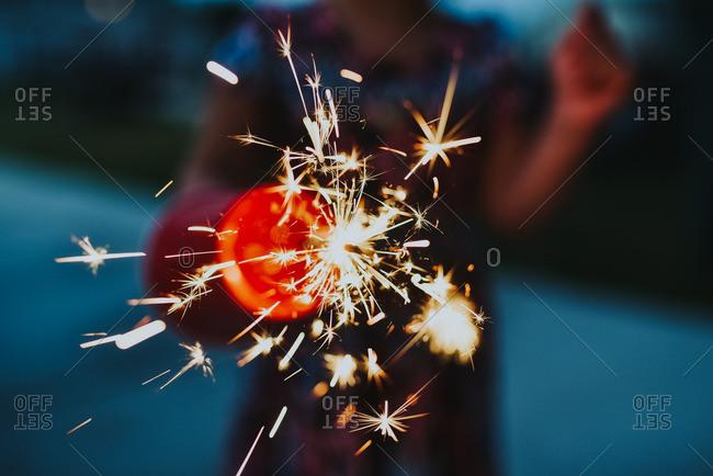 Little girl holding a sparkler