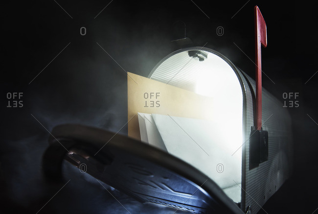 Open mailbox with envelopes