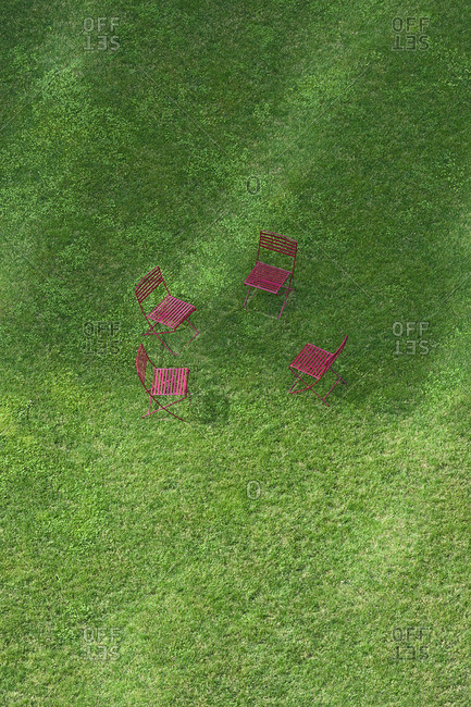 High angle view of empty chairs on grass