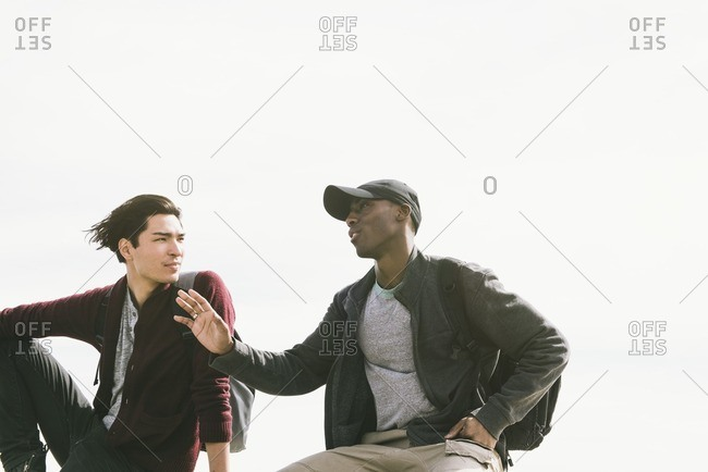 Two young men having conversation outdoors