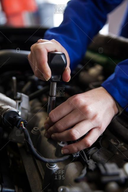 Mechanic servicing car engine at the repair garage