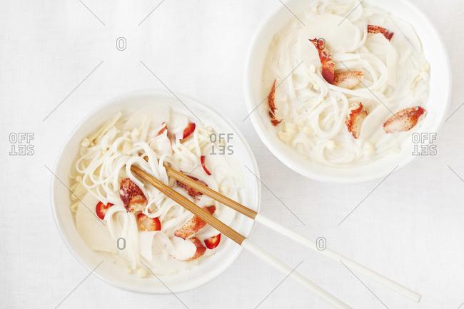 Two bowls of crab noodle soup