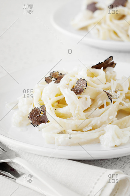 A plate of pasta with truffle shavings