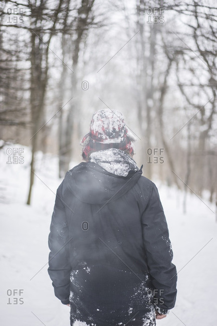 Young man enjoying Canadian winter in forest, Mont royal, Montreal, Quebec, Canada