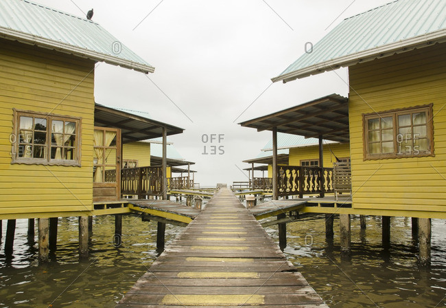 Houses in water with wood walkways, Central America