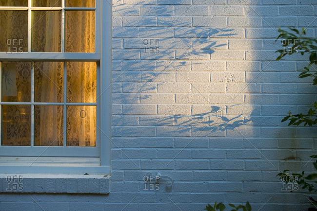 Evening shadows on house exterior
