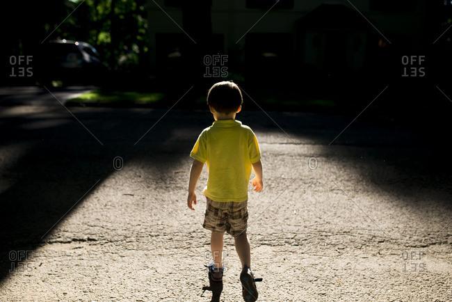 Boy on street in evening light