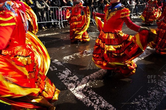 New York City, New York - February 22, 2015: Women dancing in colorful dresses at the annual Chinese New Year Parade in Chinatown