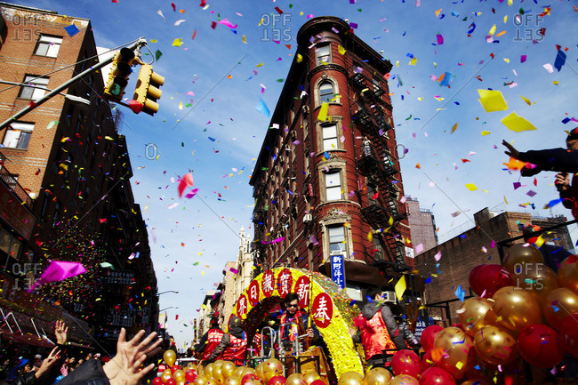 New York City, New York - February 22, 2015: Confetti flying during the annual Chinese New Year Parade in Chinatown