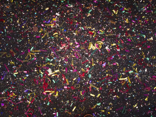 Colorful confetti against black background