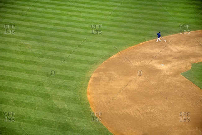Baseball park field crew maintains the infield around second base