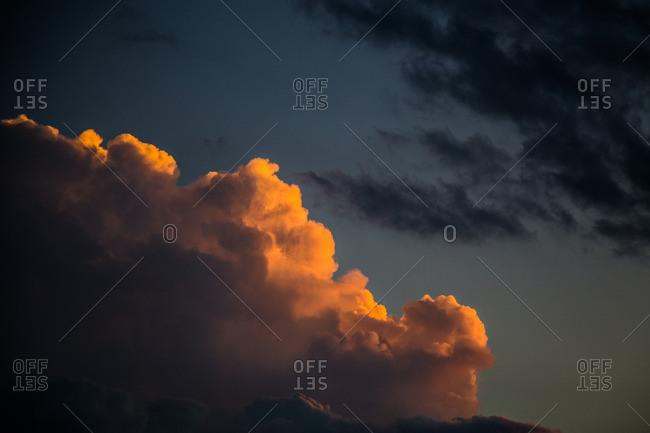 Orange clouds and dark clouds in the sky
