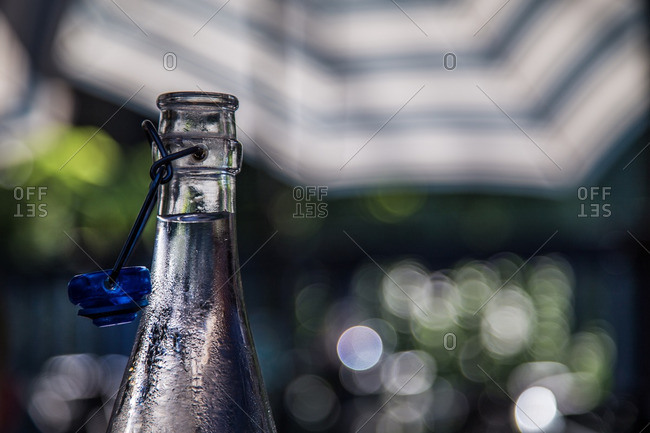 Close up of condensation on a glass bottle of water