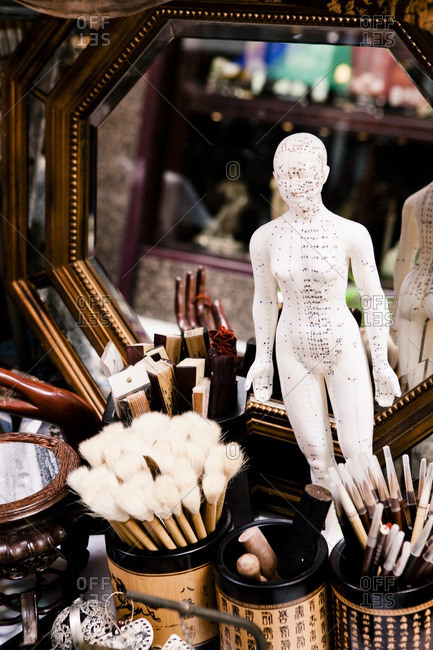 July 27, 2012: Asian antique shop with acupuncture reference doll and calligraphy brushes