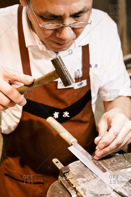 November 14, 2012: Craftsman stamping name onto a traditional Japanese knife