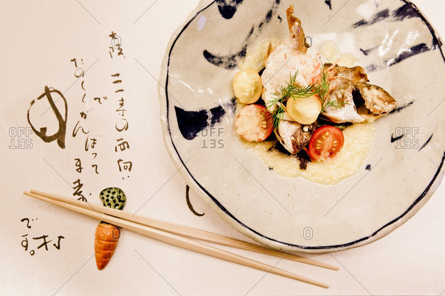 November 8, 2012: Delicately arranged appetizer on a placemat decorated with Japanese Kanji at Nakamura restaurant