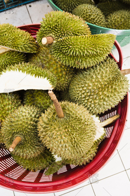 Ripe durian fruit on display at a market