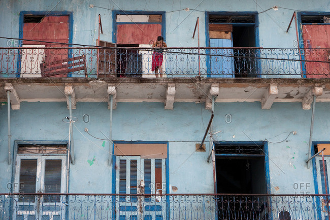 Panama City, Panama Province, Panama - March 7, 2016: woman standing on balcony in Casco Viejo, the old colonial part of Panama City