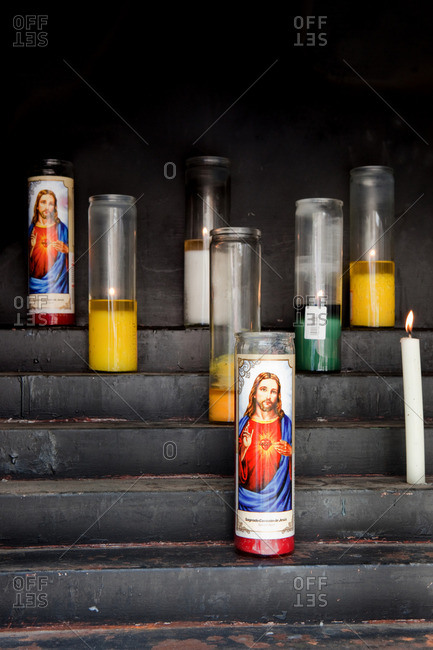 lighting candles for wishes, showing Jesus