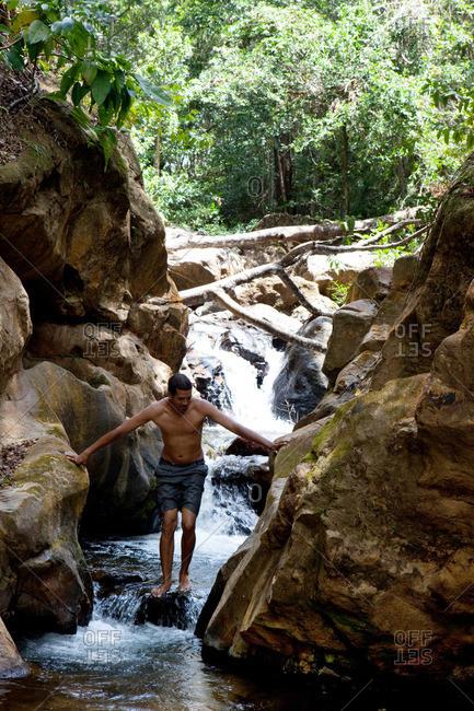 Santa Fe, Verrugas Province, Panama - March 9, 2016: man climbing waterfall in the jungle