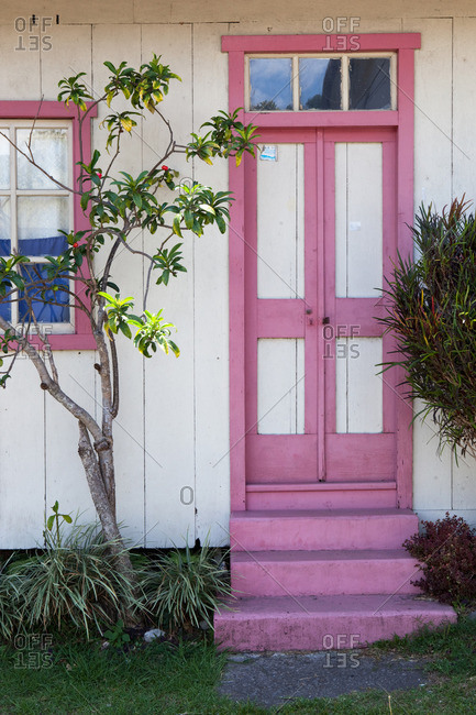 pink door of colonial house