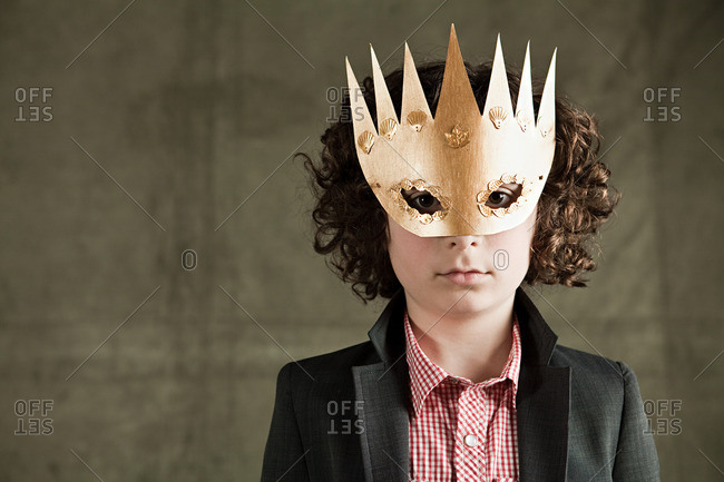 Young boy wearing gold crown mask