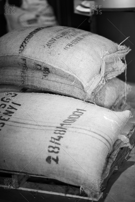 Stack of burlap sacks stamped with numbers