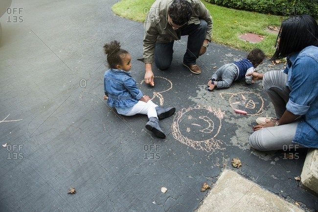 Family coloring with sidewalk chalk