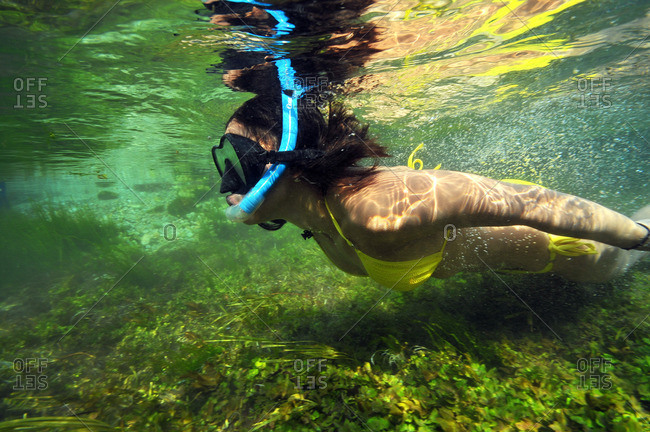 Close up of woman snorkeling underwater