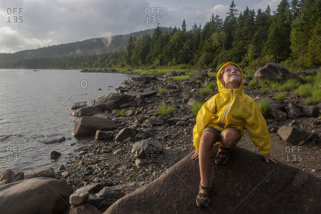 A six-year-old boy plays by Black Bear Cove on Aziscohos Lake in Lincoln Plantation, Maine
