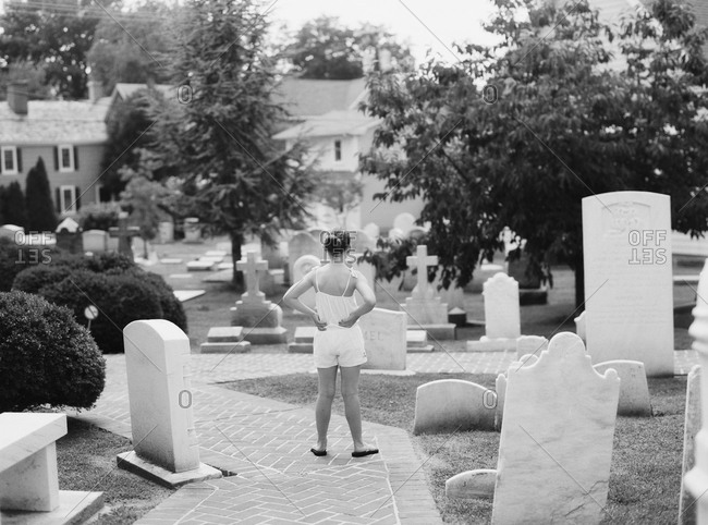 Girl standing in a cemetery