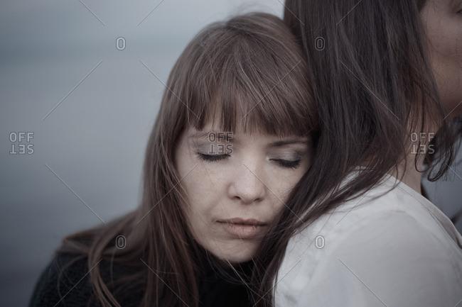Lesbian woman hugging her girlfriend