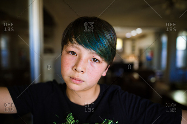 Portrait of a person with dyed blue hair
