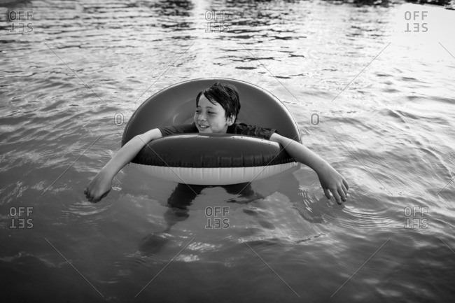 Boy floating in a life ring in a swimming pool