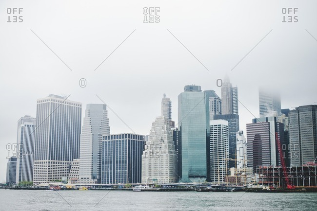 Buildings of Lower Manhattan under foggy skies
