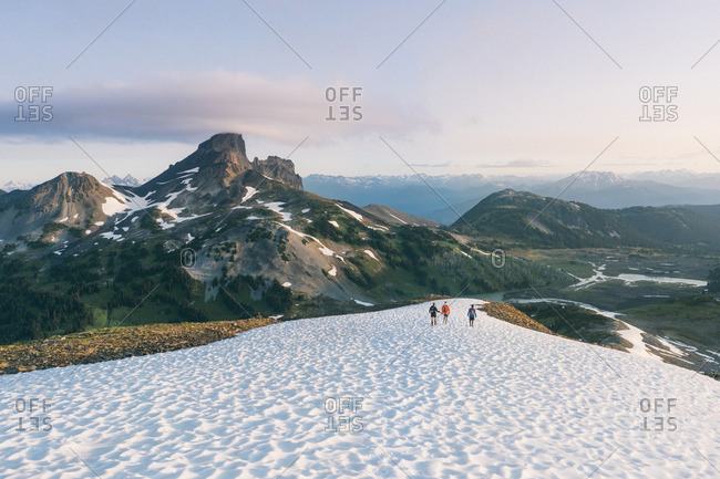 People walking on snowy trail in mountains, British Columbia