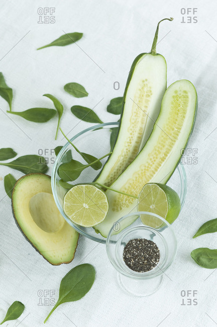 Superfood, chia seeds, cucumber, avocado, spinach and lime in bowl