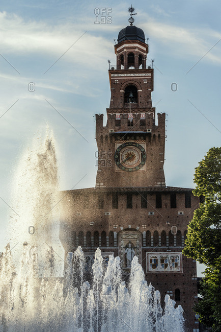 Italy, Milan, view to Sforza Castle with fountain in the foreground