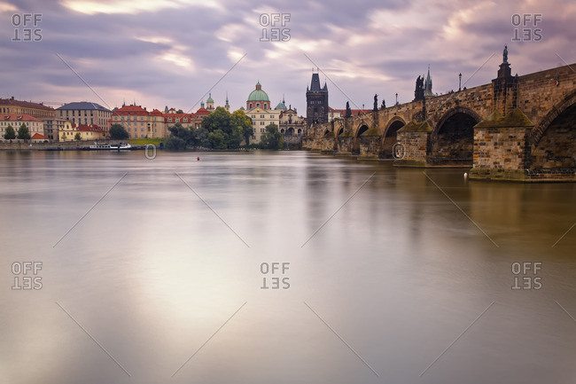 Czech Republic, Prague, Old town, Vlatva river, Charles Bridge and Old Town Bridge Tower in the evening