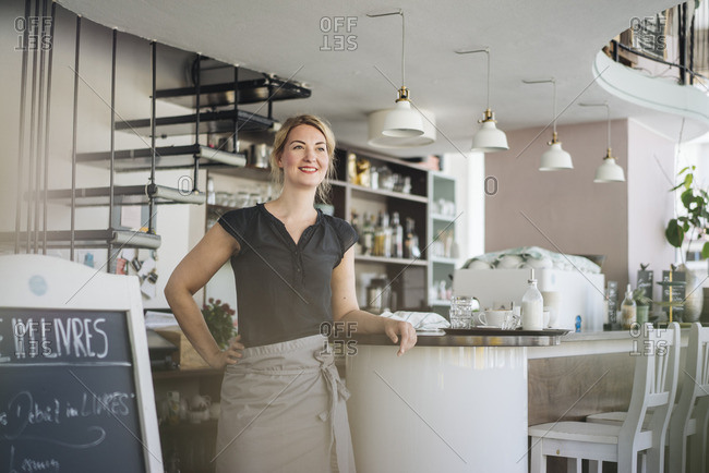 Smiling woman in a cafe