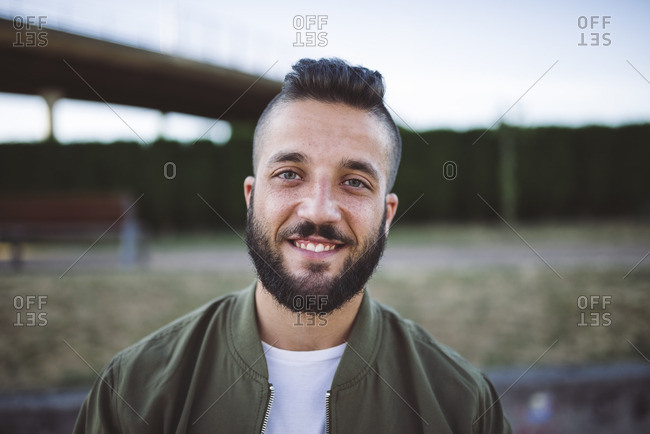 Portrait of smiling man with beard and shaved head