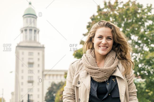 Germany, Berlin, portrait of happy blond woman