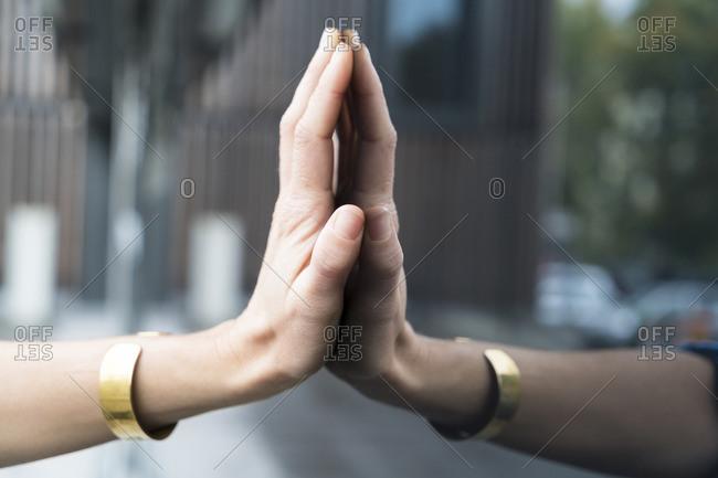 Woman's hand touching glass pane