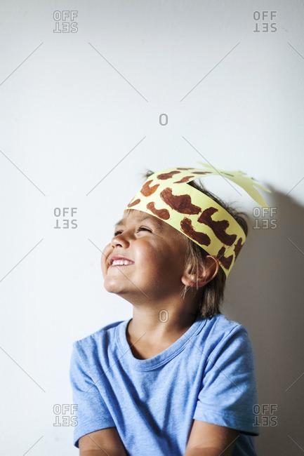 Happy little boy wearing self, made headdress