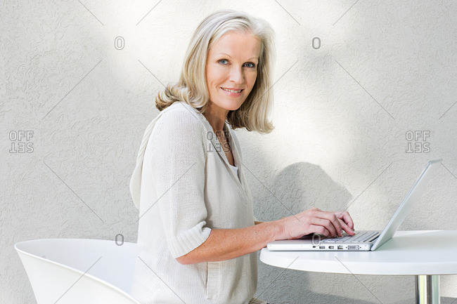 Middle aged woman using laptop