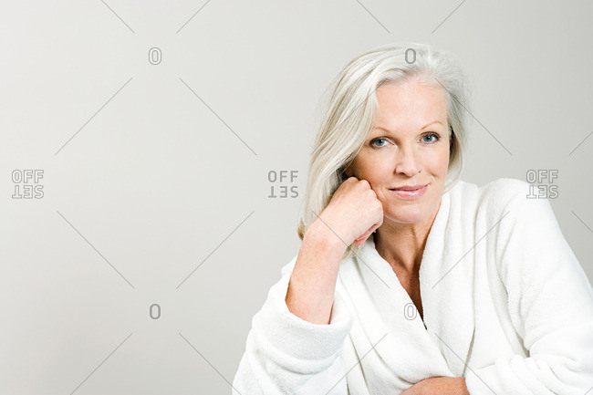 Portrait of middle aged woman wearing bathrobe